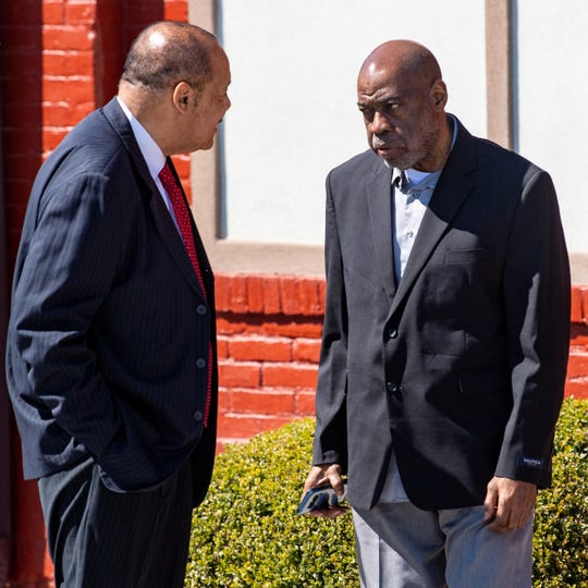 Charles Benjamin, right, talks with his attorney, Clarence Allen, before entering his preliminary hearing before District Justice Jennifer J.P. Clancy.