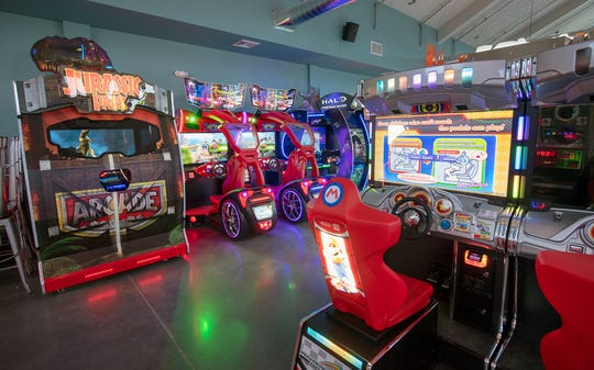 There are more than 30 arcade games at White Rose at Bridgewater in a large room with raised seating.