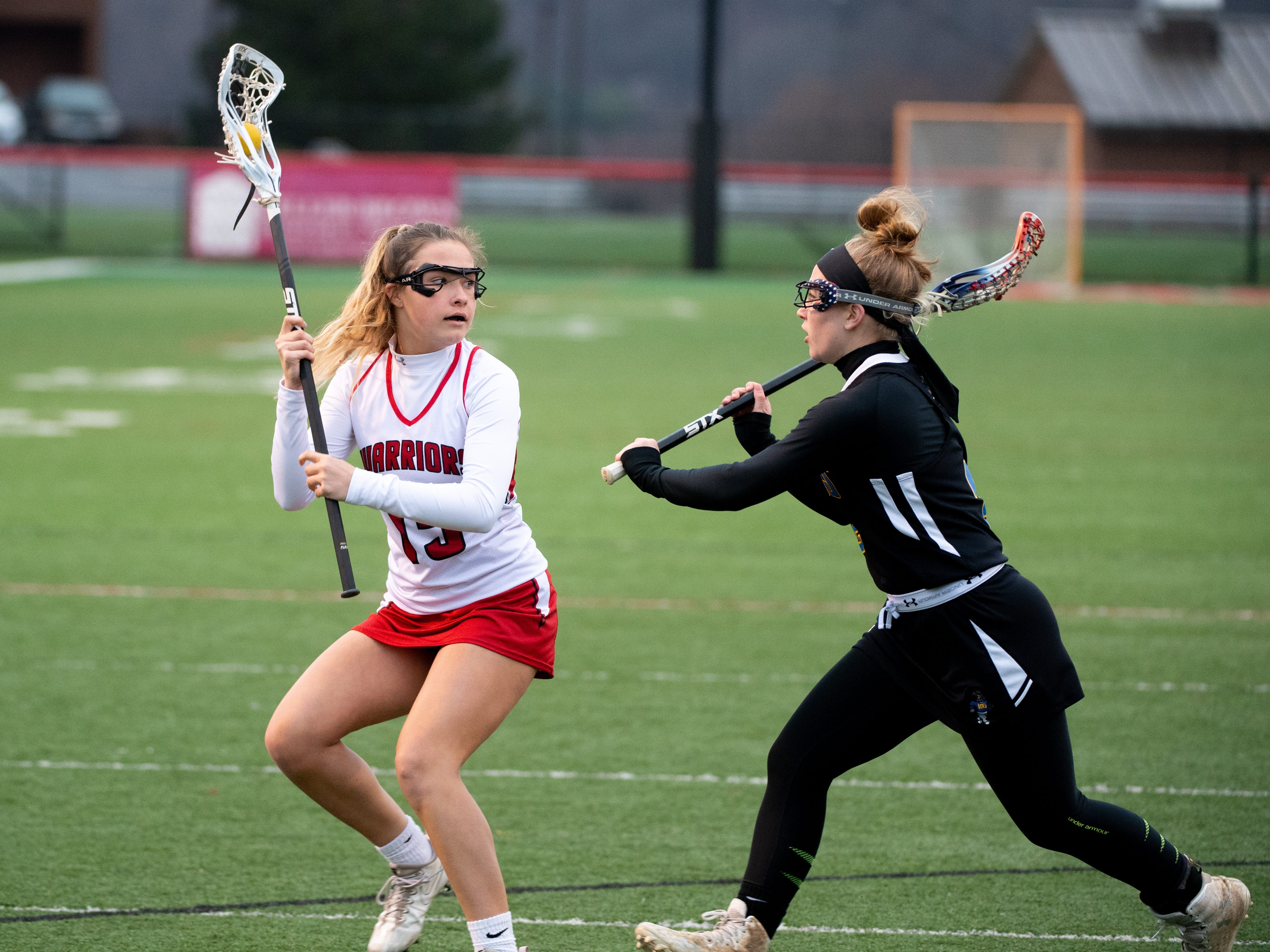 Kalen Hancock (15) protects the ball during the girls' lacrosse game between Susquehannock and Kennard-Dale, April 2, 2019 at Susquehannock High School. The Rams defeated the Warriors 17 to 2.