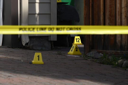 Crime scene markers and police tape marked the front yard of a home on the 1000 block of Crown Drive in north Reno on Wednesday, April 3. Police are investigating a homicide at the residence after a body was found outside the home the night before.