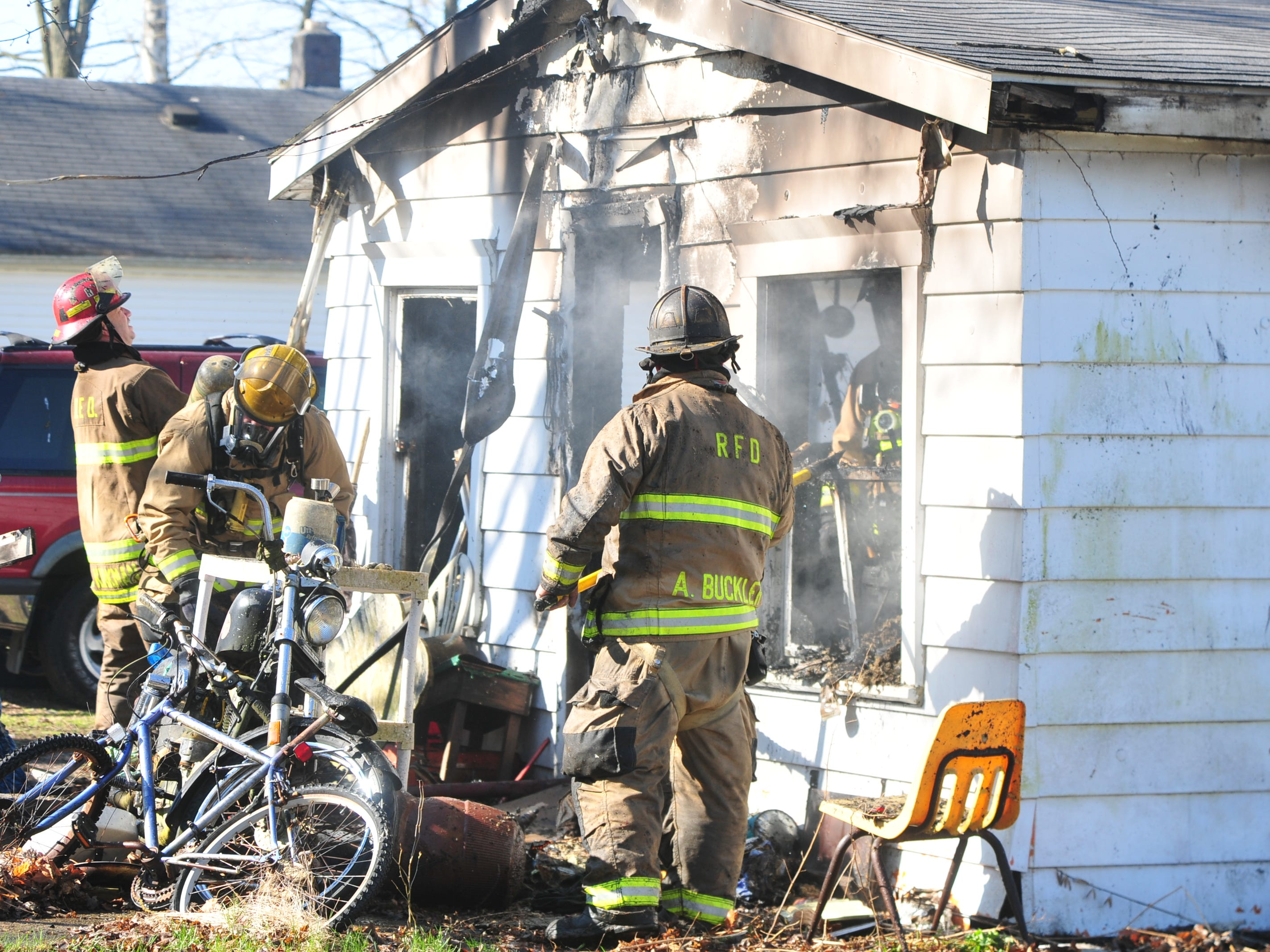 Richmond Fire Department personnel works Wednesday morning at a house fire in the 2100 block of South 11th Street.