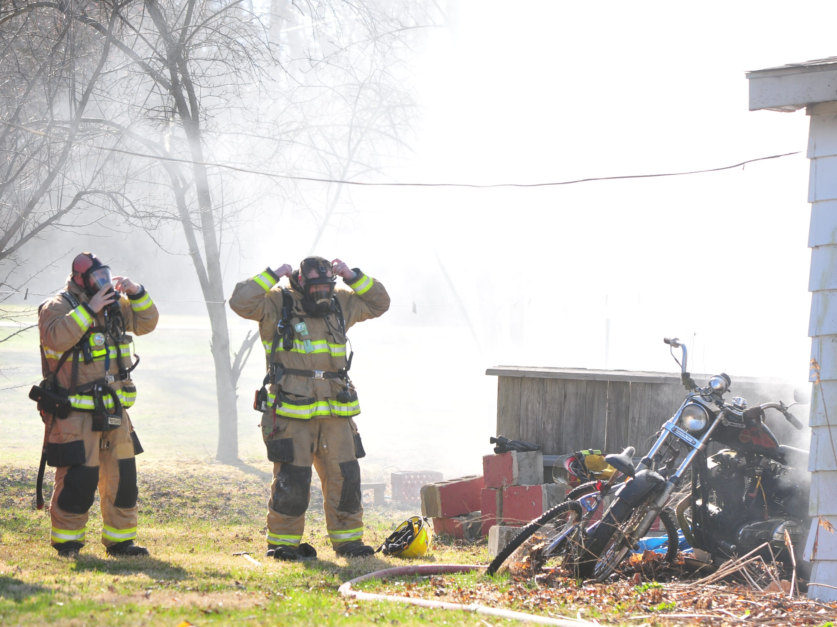 Richmond Fire Department personnel puts on gear to enter a house in the 2100 block of South 11th Street.