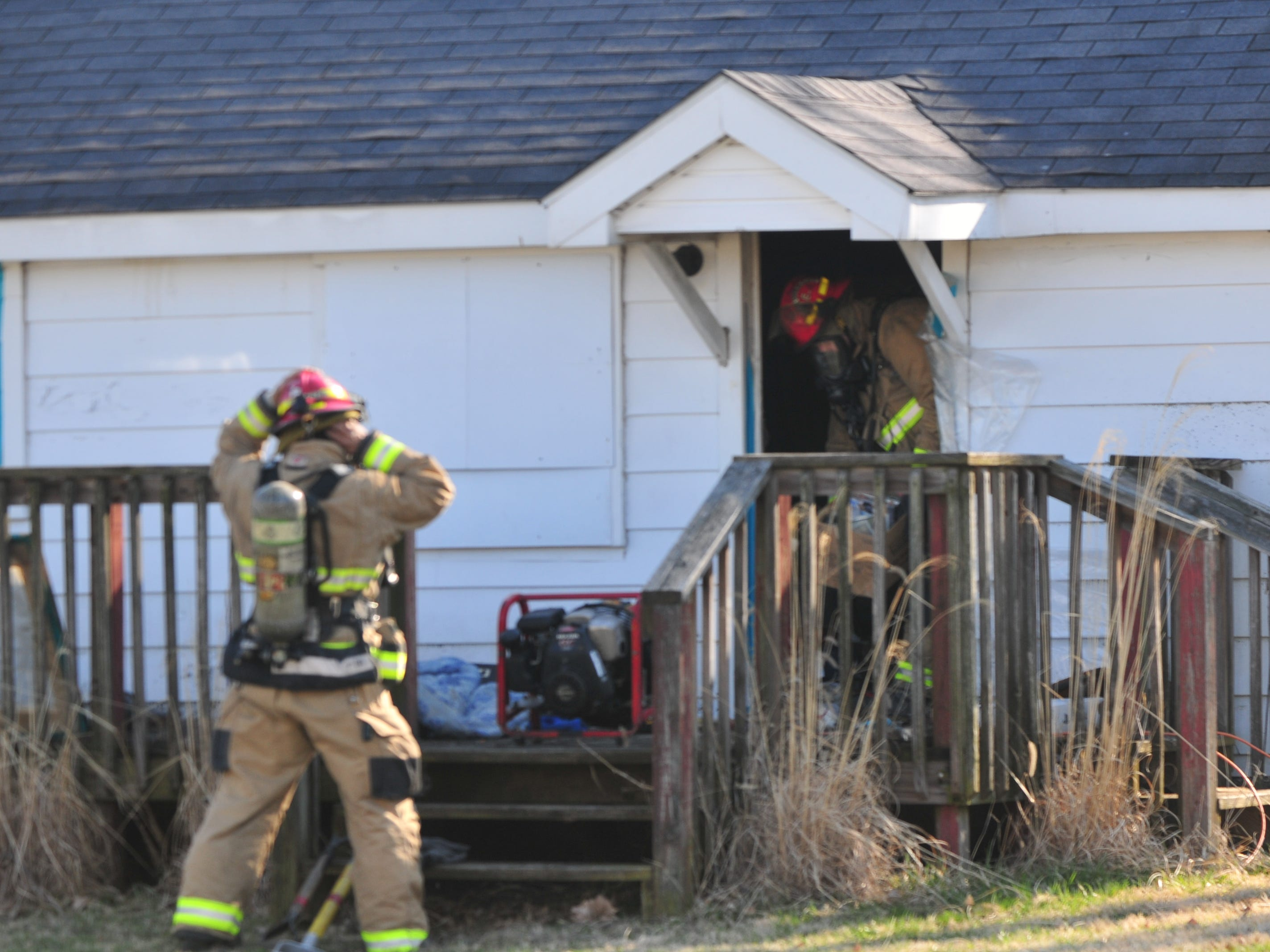Richmond Fire Department personnel works to clear items from a house in the 2100 block of South 11th Street.