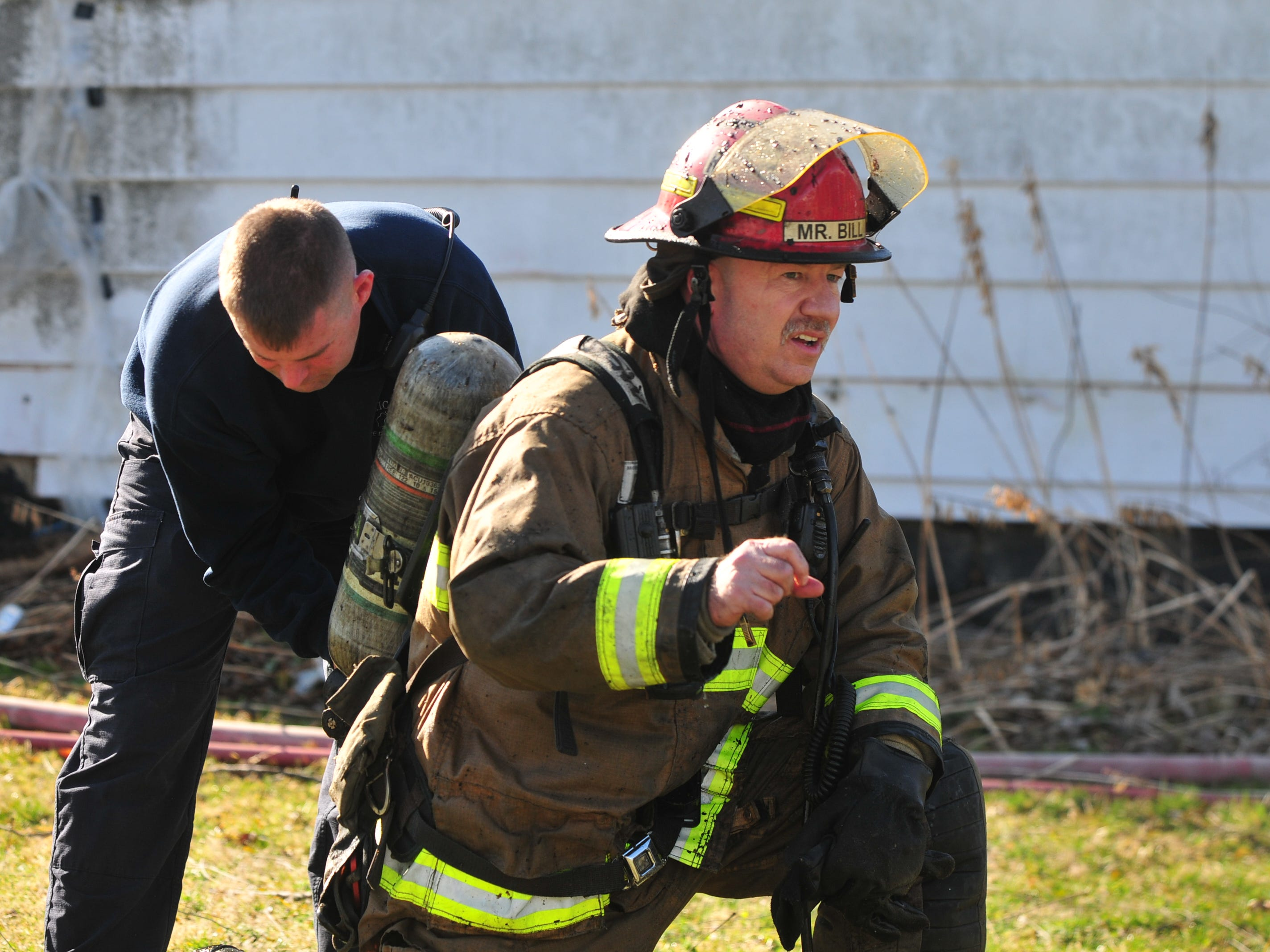 Lt. Bill Kirkman has his air tank changed Wednesday morning at a house fire in the 2100 block of South 11th Street.