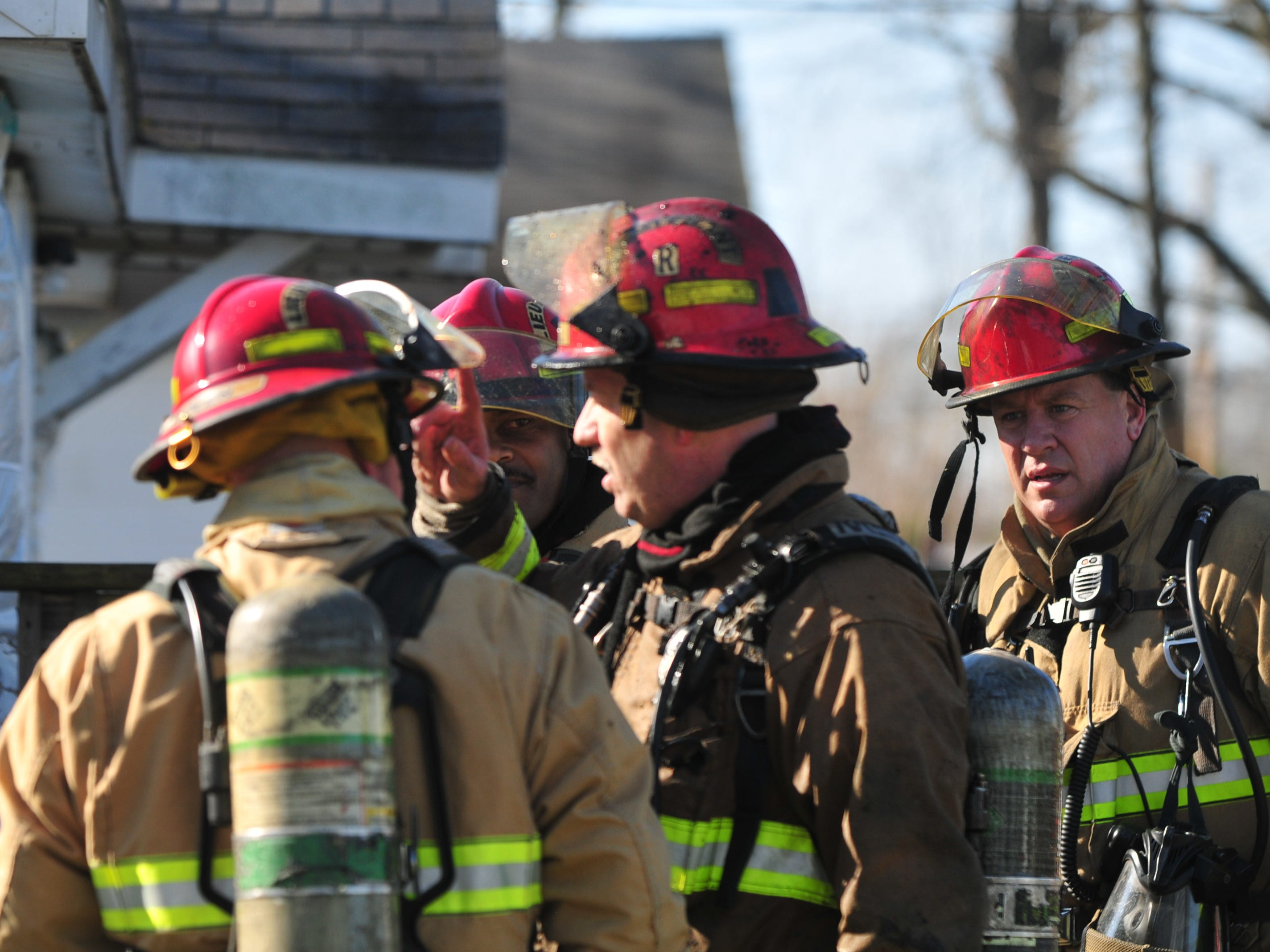 Richmond Fire Department personnel discuss a house fire Wednesday morning in the 2100 block of South 11th Street.