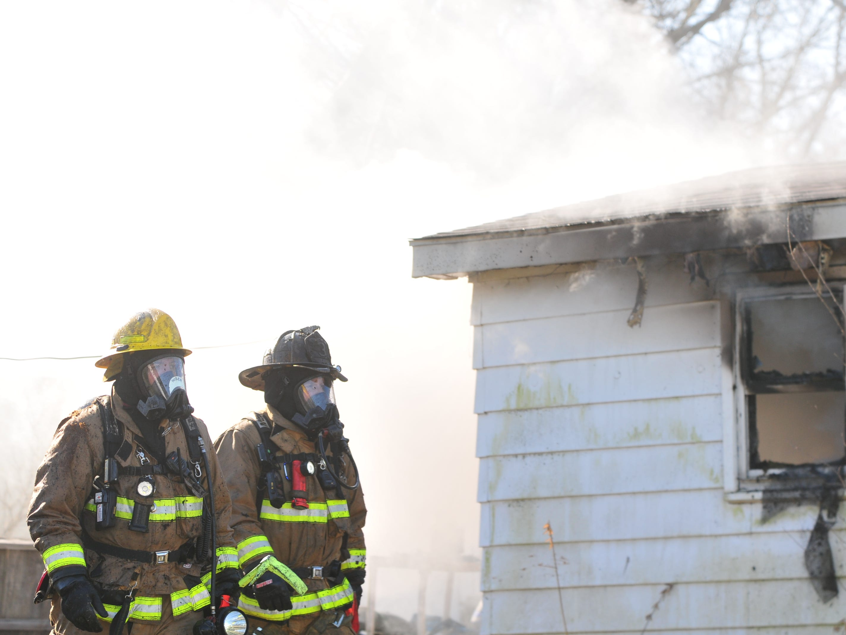 Smoke pours from a house in the 2100 block of South 11th Street as Richmond Fire Department personnel extinguished a fire Wednesday morning.