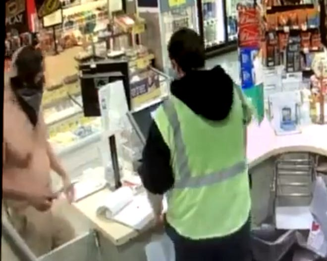 Surveillance video shows a shirtless man with a knife robbing the Safeway gas station in Anderson on March 30, 2019. Anderson police are looking for the robber, described as a Hispanic man who may have fled in a mid-size pickup.