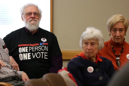 People wear shirts in support of the national popular vote during a hearing  April 2, 2019 for Senate Bill 870.