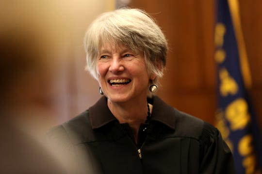 Oregon Supreme Court Chief Justice Martha Walters talks to people during a swearing in ceremony for the new Secretary of State Bev Clarno at the Oregon State Capitol in Salem on April 3, 2019.