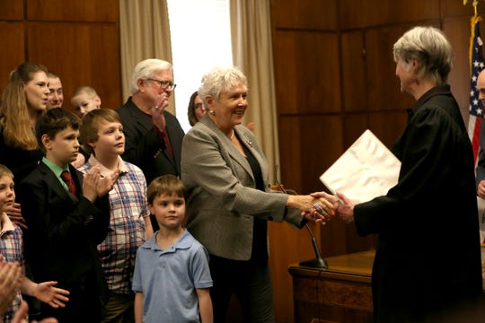 Secretary of State Bev Clarno shakes hands with Oregon Supreme Court Chief Justice Martha Walters at the Oregon State Capitol in Salem on April 3, 2019.