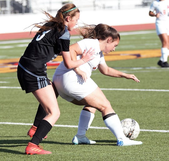 San Angelo Central's Averi Handy (right) battles for the ball during a Class 6A area soccer playoff against Odessa Permian at Abilene Wylie's Bulldog Stadium on Tuesday, April 2, 2019.