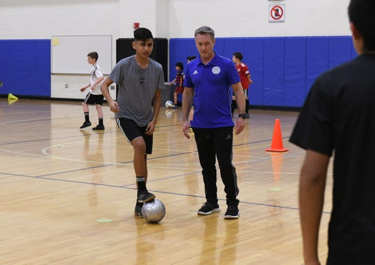 Bryan Watson, North American and U.S. President for Matrix Soccer Academy, leads a group through skill drills on Tuesday, April 3, 2019.