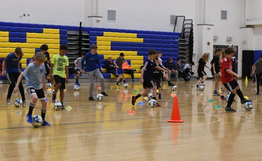 Students of the Matrix Soccer Academy work on skill and technique during practice on Tuesday, April 3, 2019.