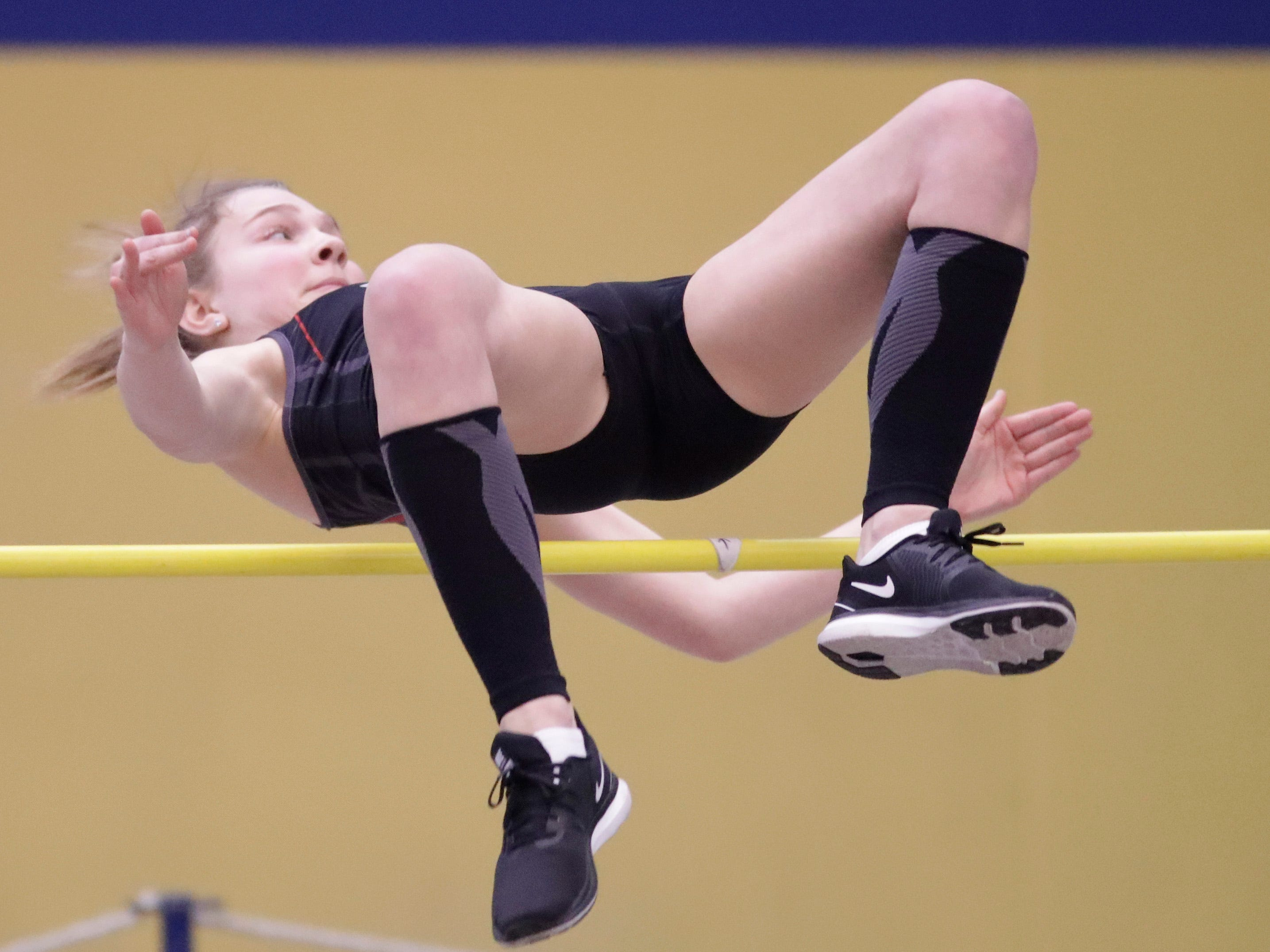 Manitowoc Lincoln's Madalynn Buchner clears the bar at the Sheboygan North Invite track meet, Tuesday, April 2, 2019, in Sheboygan, Wis.