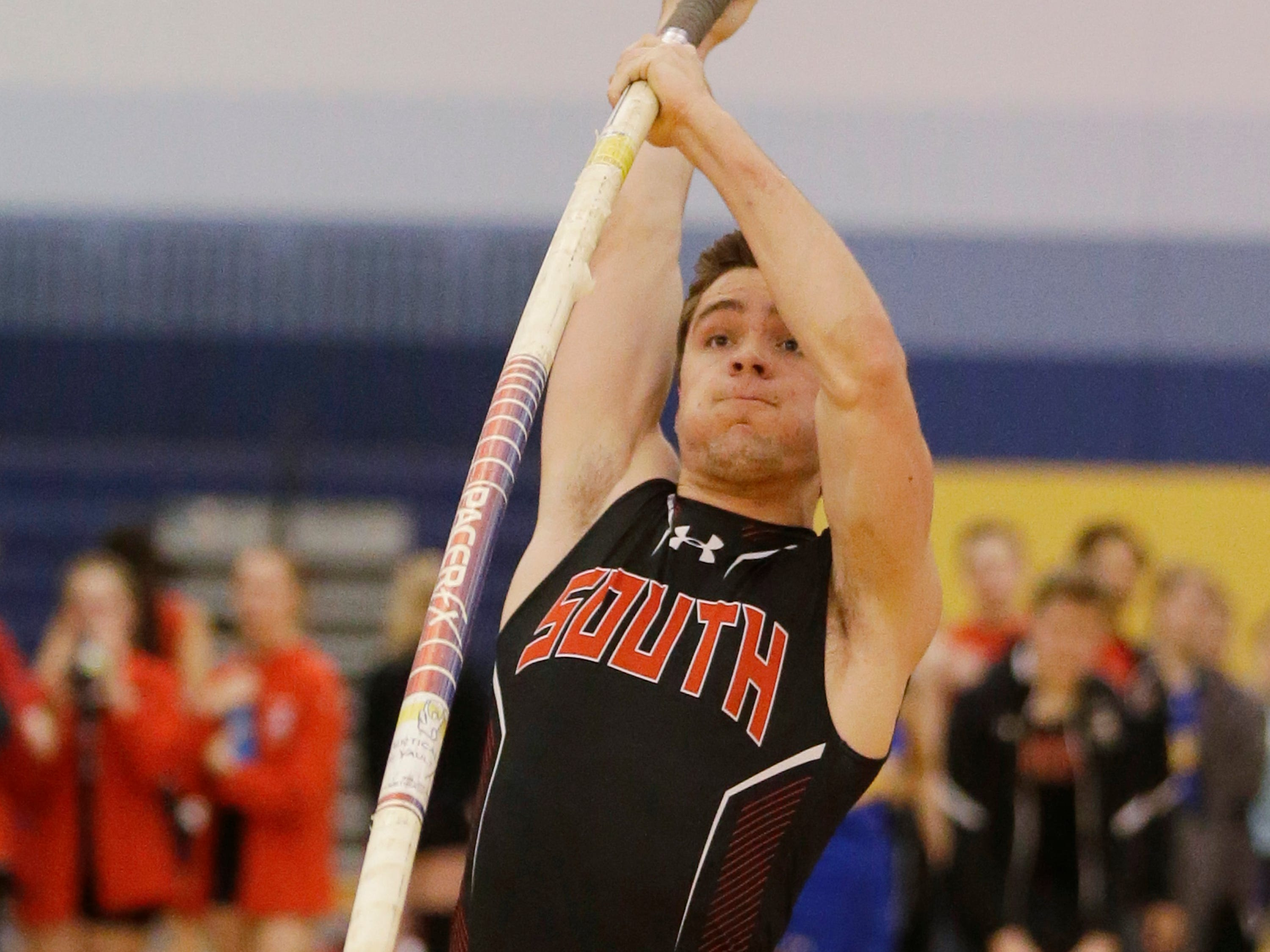 Sheboygan South's Ross Kovacic plants the pole vault during an attempt at the Sheboygan North Invite track meet, Tuesday, April 2, 2019, in Sheboygan, Wis.