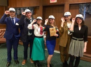 The delegates with their Sheboygan hats and their key to the city.