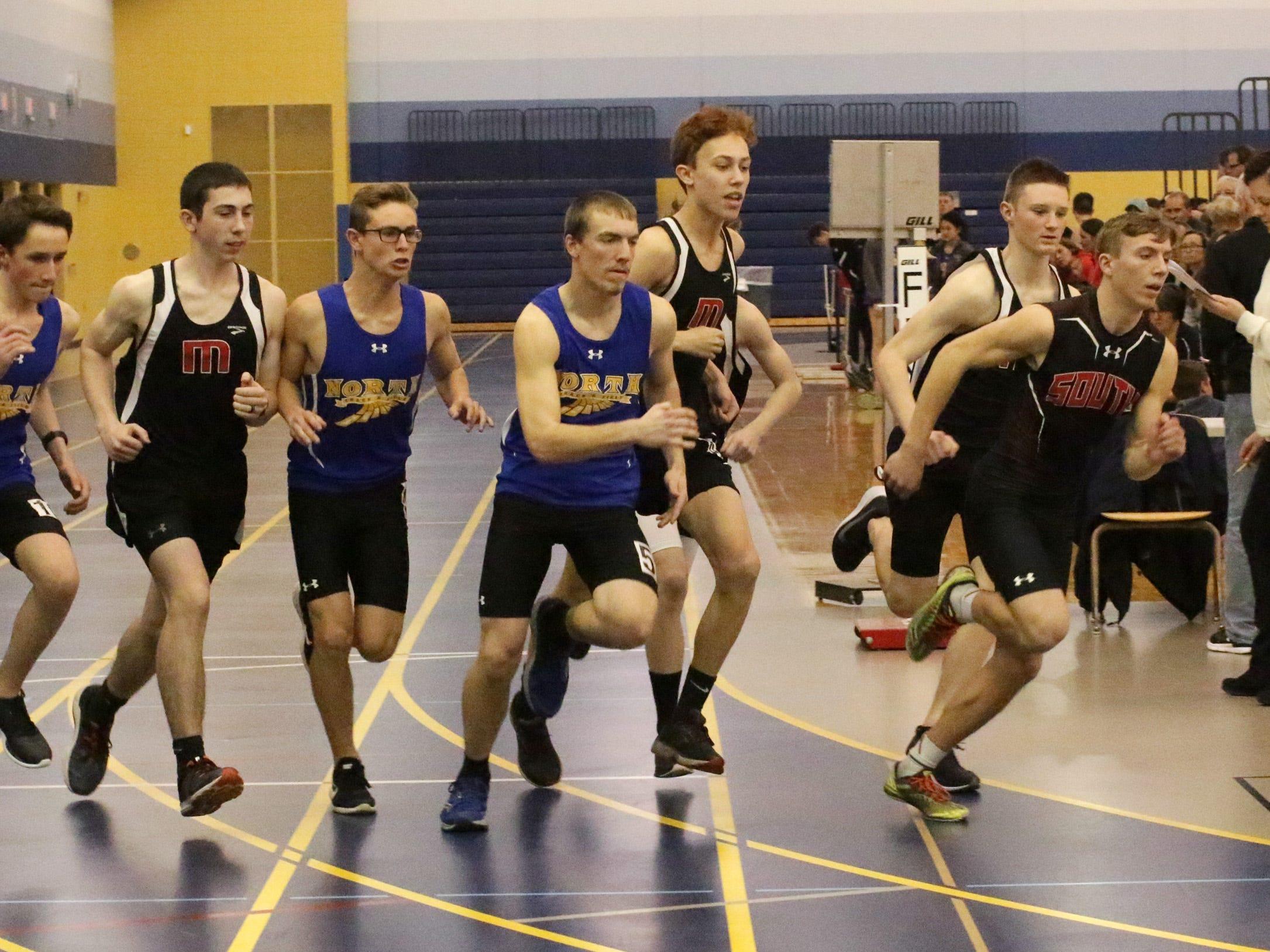 Boys start the 1600 at the Sheboygan North Invite track meet, Tuesday, April 2, 2019, in Sheboygan, Wis.