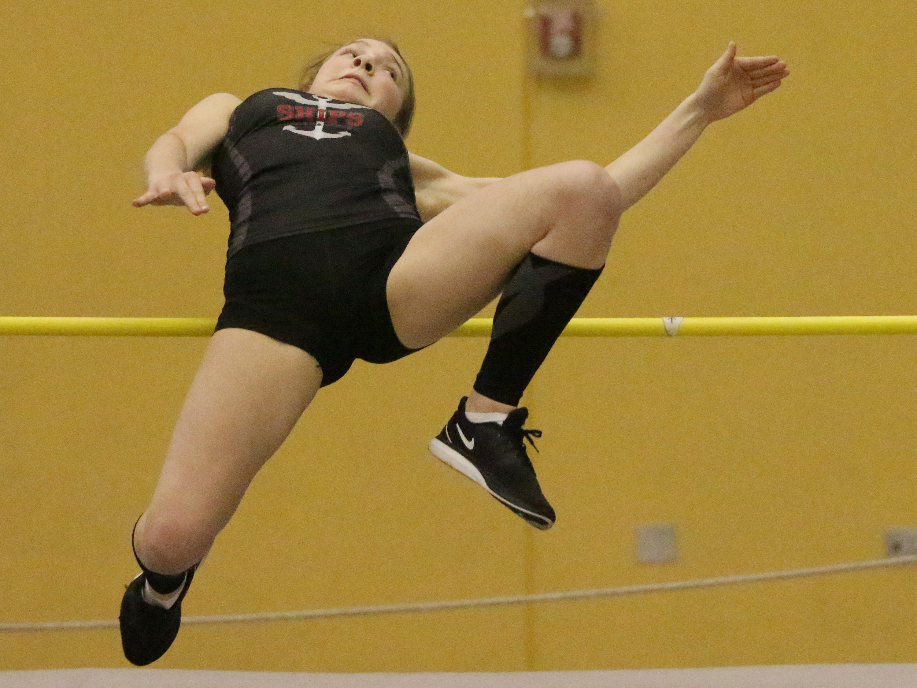 Manitowoc's Madalynn Buchner works to clear the bar during the Sheboygan North Invite track meet, Tuesday, April 2, 2019, in Sheboygan, Wis.