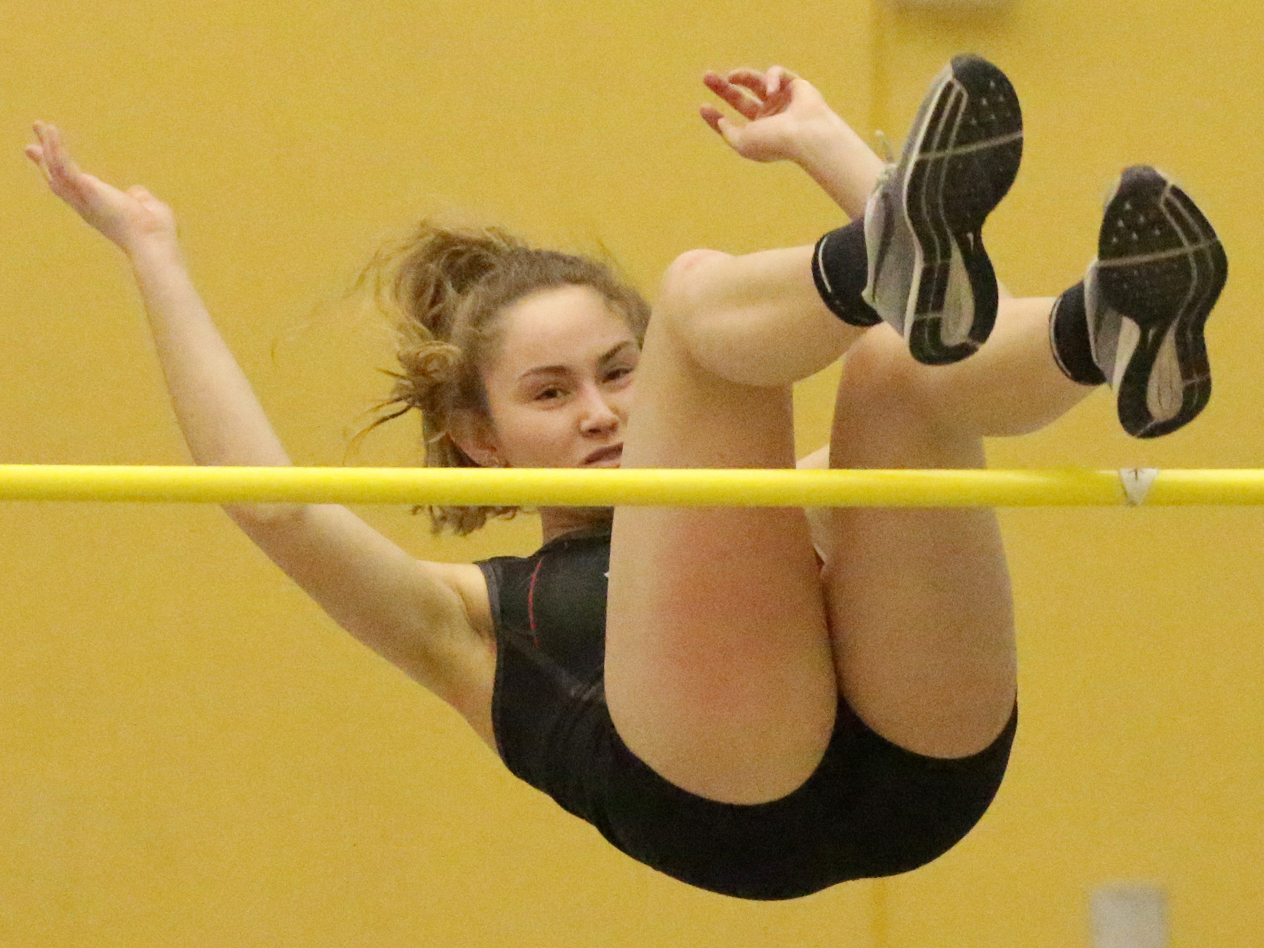 Manitowoc's Lauren Borchardt clears the bar during the Sheboygan North Invite track meet, Tuesday, April 2, 2019, in Sheboygan, Wis.