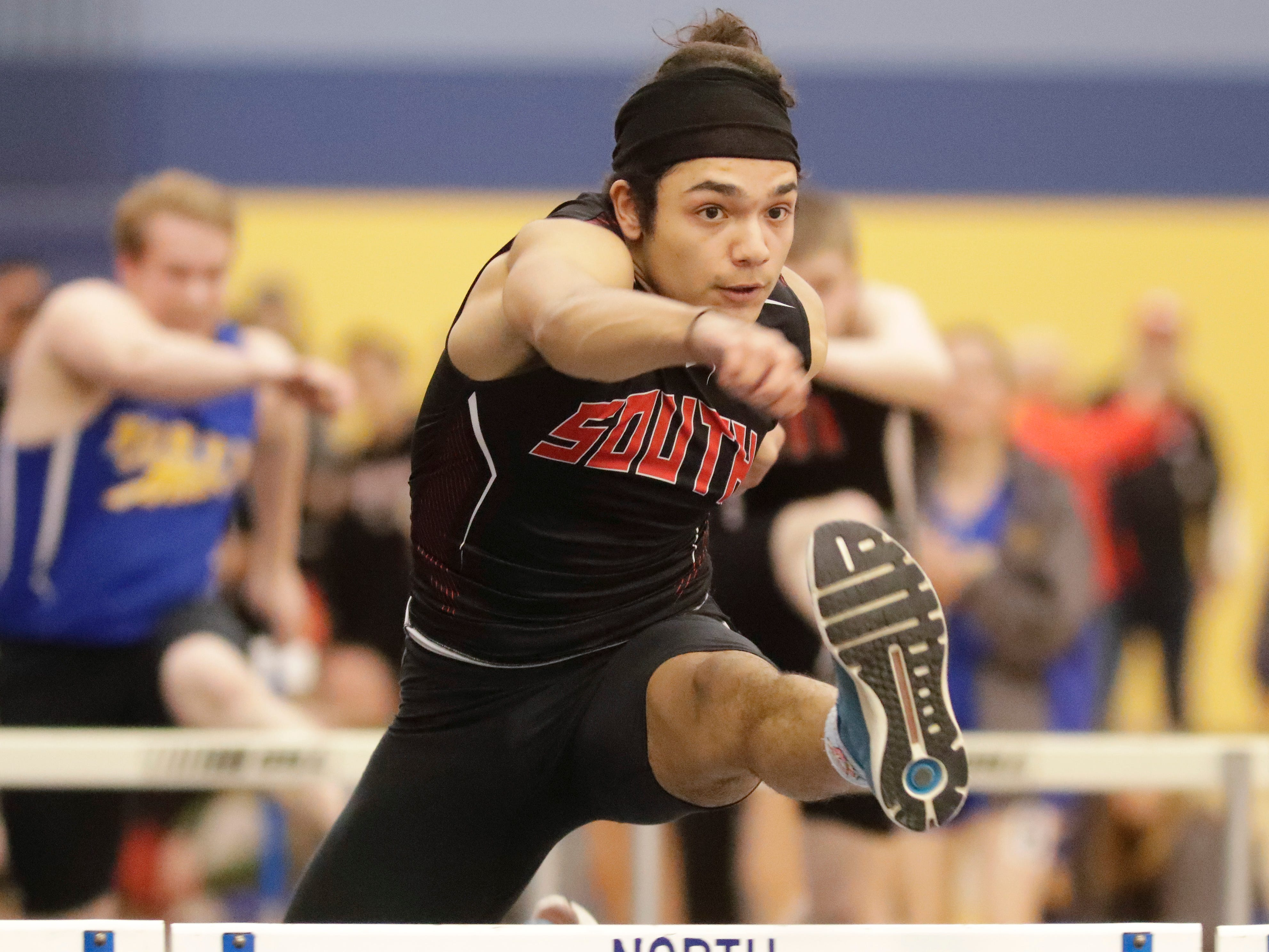 Sheboygan South's Anthony Pernell-McGinnis leads in the 55 meter high hurdles at the Sheboygan North Invite track meet, Tuesday, April 2, 2019, in Sheboygan, Wis.