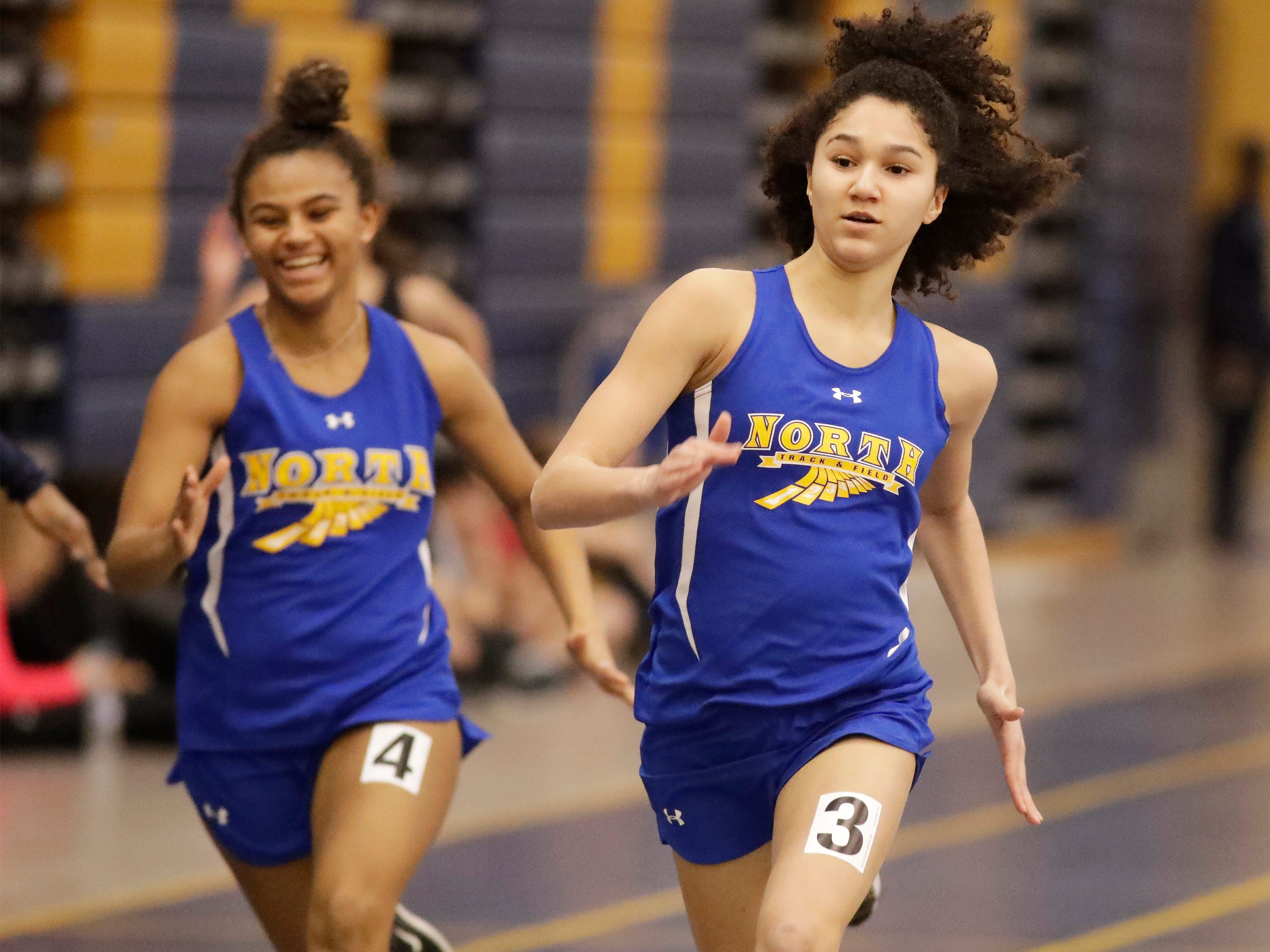 Nyla Spicer (4) and  Alexis Johnson (3) sprint in 55 meter dash at the Sheboygan North Invite track meet, Tuesday, April 2, 2019, in Sheboygan, Wis.
