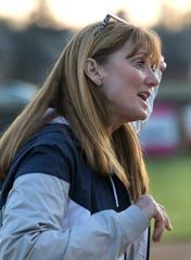 North DeSoto coach Lori McFerren exhorts her team during Tuesday's district game against Northwood.