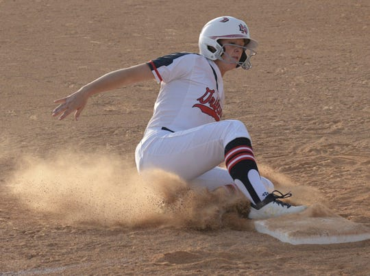 North DeSoto's Lexi Hutchins is safe at third in their Tuesday game against Northwood.
