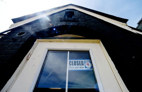 A closed sign hangs in the door of Cannabis with Love around 1 p.m. on Wednesday.