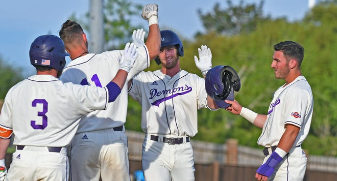 Tyler Smith (center) gets congratulated after his three-run home run Tuesday against Mississippi Valley State.