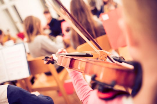 Playing violin in a youth orchestra
