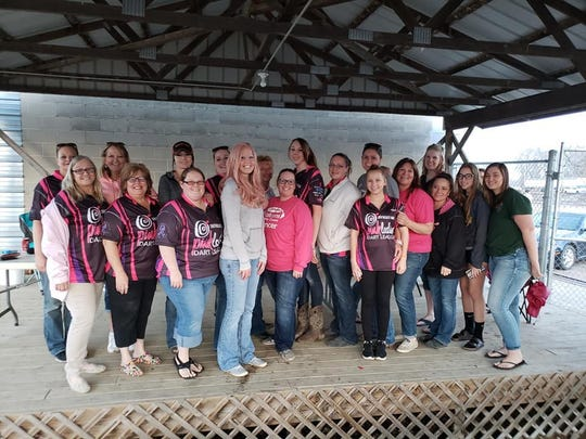 """Members of the Southeast Area Pink Ladies stand with April Steen, center, in this undated submitted photo. The group and its """"Chase the Queen' fundraiser drawing in Hudson are supporting Steen's battle with breast cancer, as well as others in the area struggling with cancer. The fundraiser's pot stands at $216,133."""