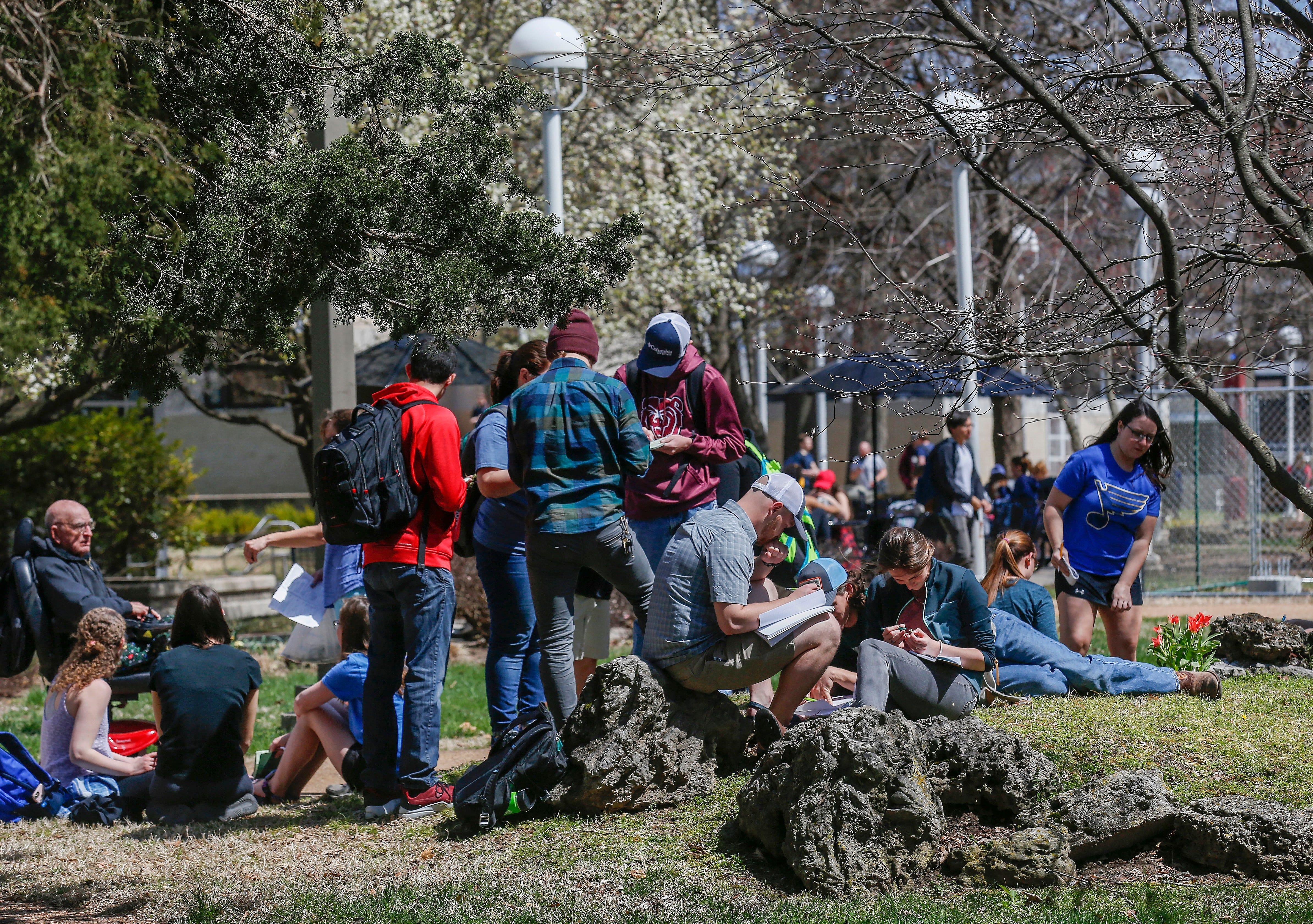 "Students work outside of Plaster Student Union at Missouri State University on Wednesday, April 3, 2019. A measure added to a bill allowing colleges to designate employees as ""campus security officers"" and to allow concealed weapons on campus passed in the Missouri House of Representatives."