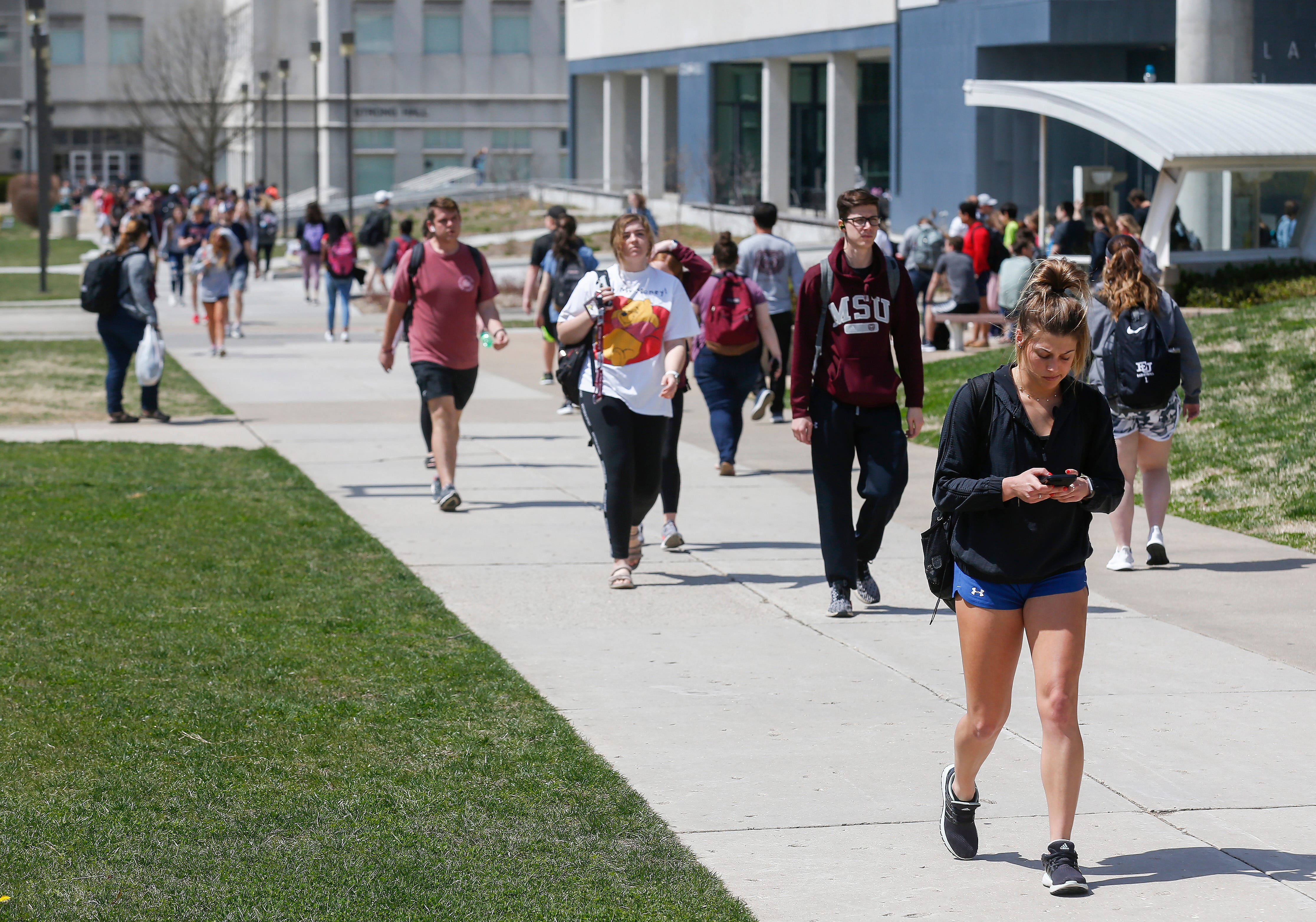 Students walk on campus at Missouri State University on Wednesday, April 3, 2019.