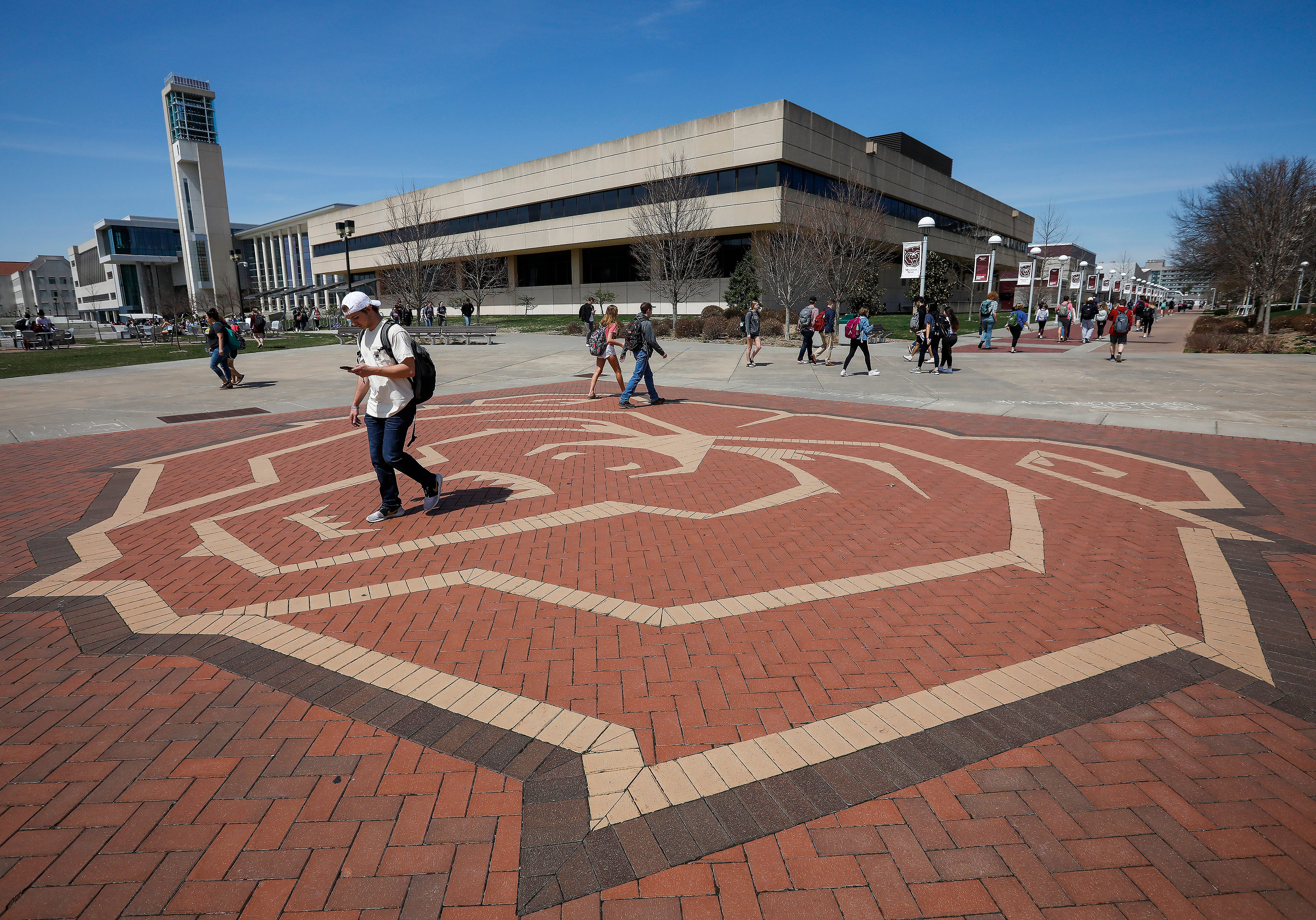 """Students walk on campus at Missouri State University on Wednesday, April 3, 2019. A measure added to a bill allowing colleges to designate employees as """"campus security officers"""" and to allow concealed weapons on campus passed in the Missouri House of Representatives."""