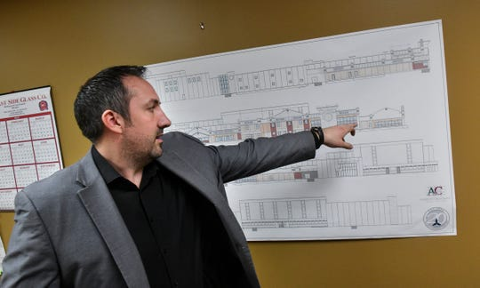General manager Benjamin Copperthite talks about planned changes for Midtown Square storefronts Wednesday, April 3, in St. Cloud.