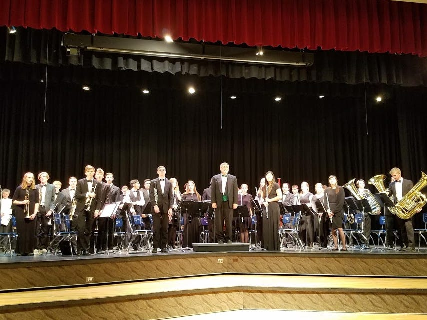 Snow Canyon High School's symphonic band is directed by Terry Moore.
