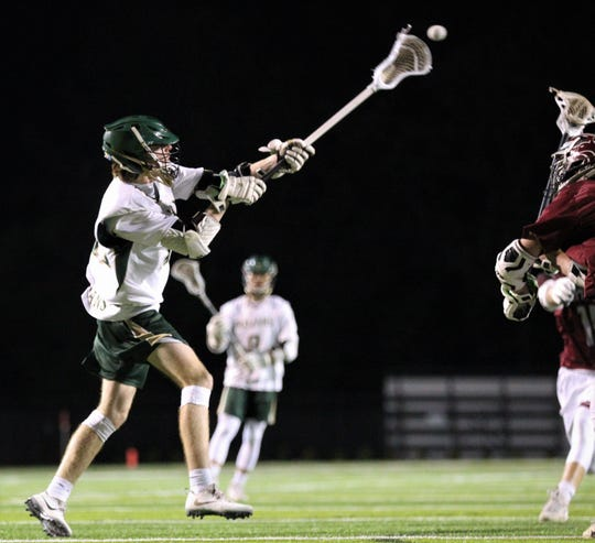 Lincoln junior Morgan Bell takes a shot for a goal as the Trojans beat Chiles 14-8 on Tuesday, April 2, 2019 at Gene Cox Stadium.