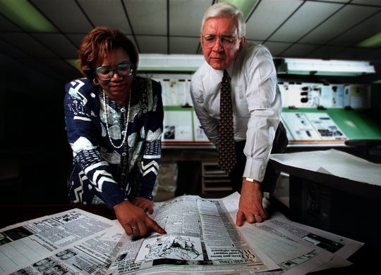 Former publisher Carrol Dadisman looks over the next day's editorial with then-executive editor Lorraine Branham in 1996. Under Dadisman, the Tallahassee Democrat grew from two sections to four sections daily, redesigned its appearance and expanded local news coverage.
