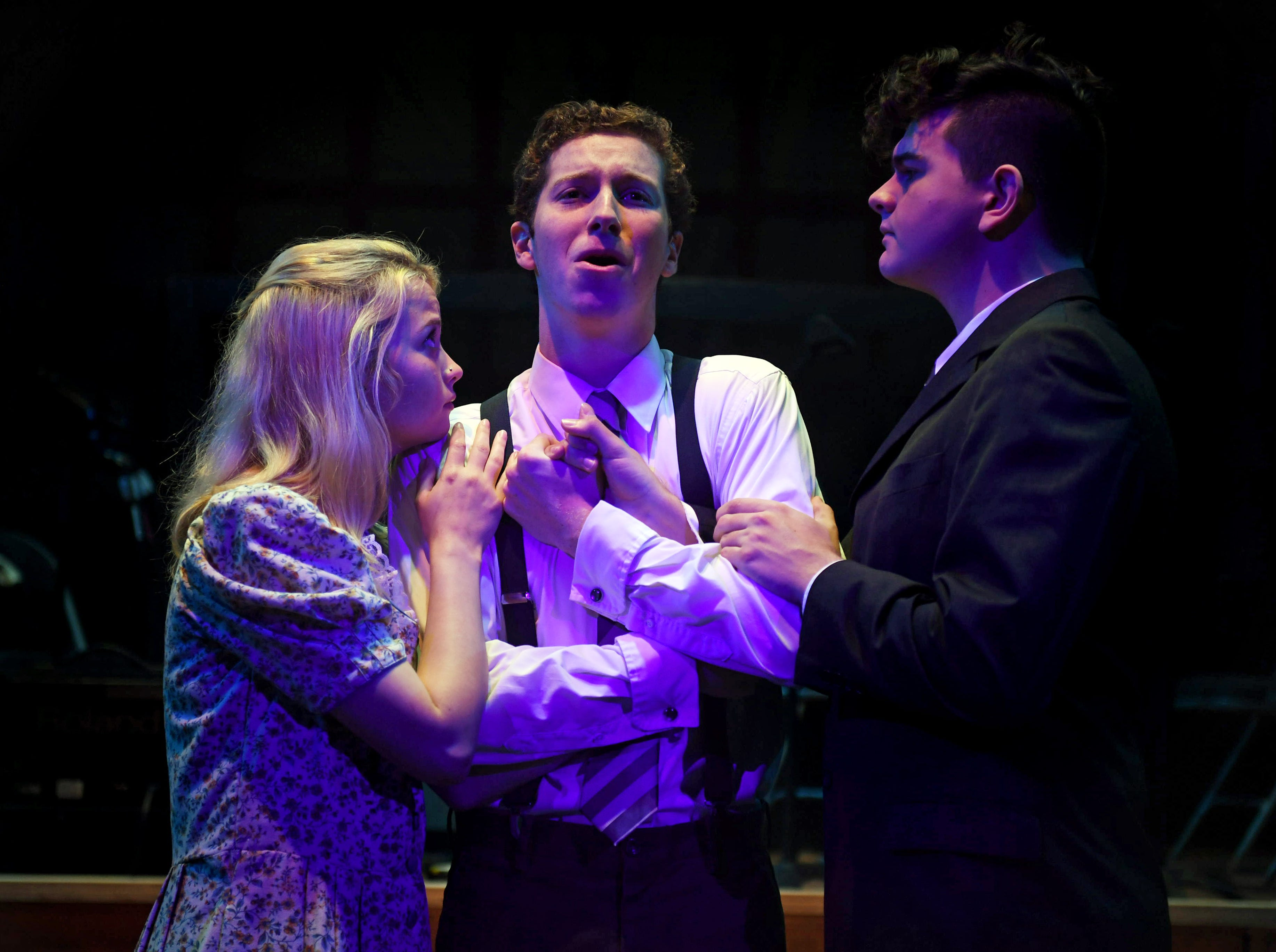 """Melchior (Spencer Lail, center) is comforted by his friends, Wendla (Hannah MacGregor) and Moritz (Tristan Ferrara) in TheatreTCC's production of """"Spring Awakening."""""""