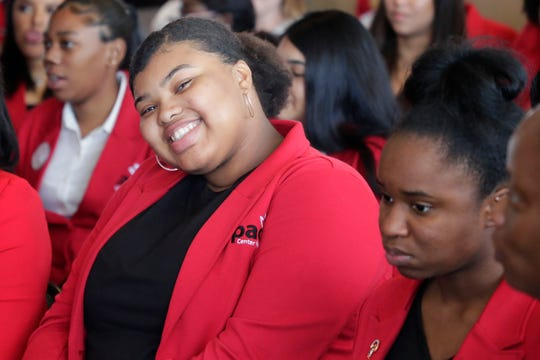 Sarah Glass, a student in the Pace Center for Girls program, 15, smiles for a photo  during the Pace Center for Girls day at the Capitol Wednesday, April 3, 2019.