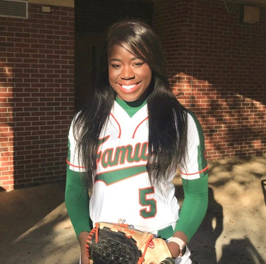 Senior outfielder Alexis Day is all smiles before taking the field at the FAMU Softball Complex in a recent home game.