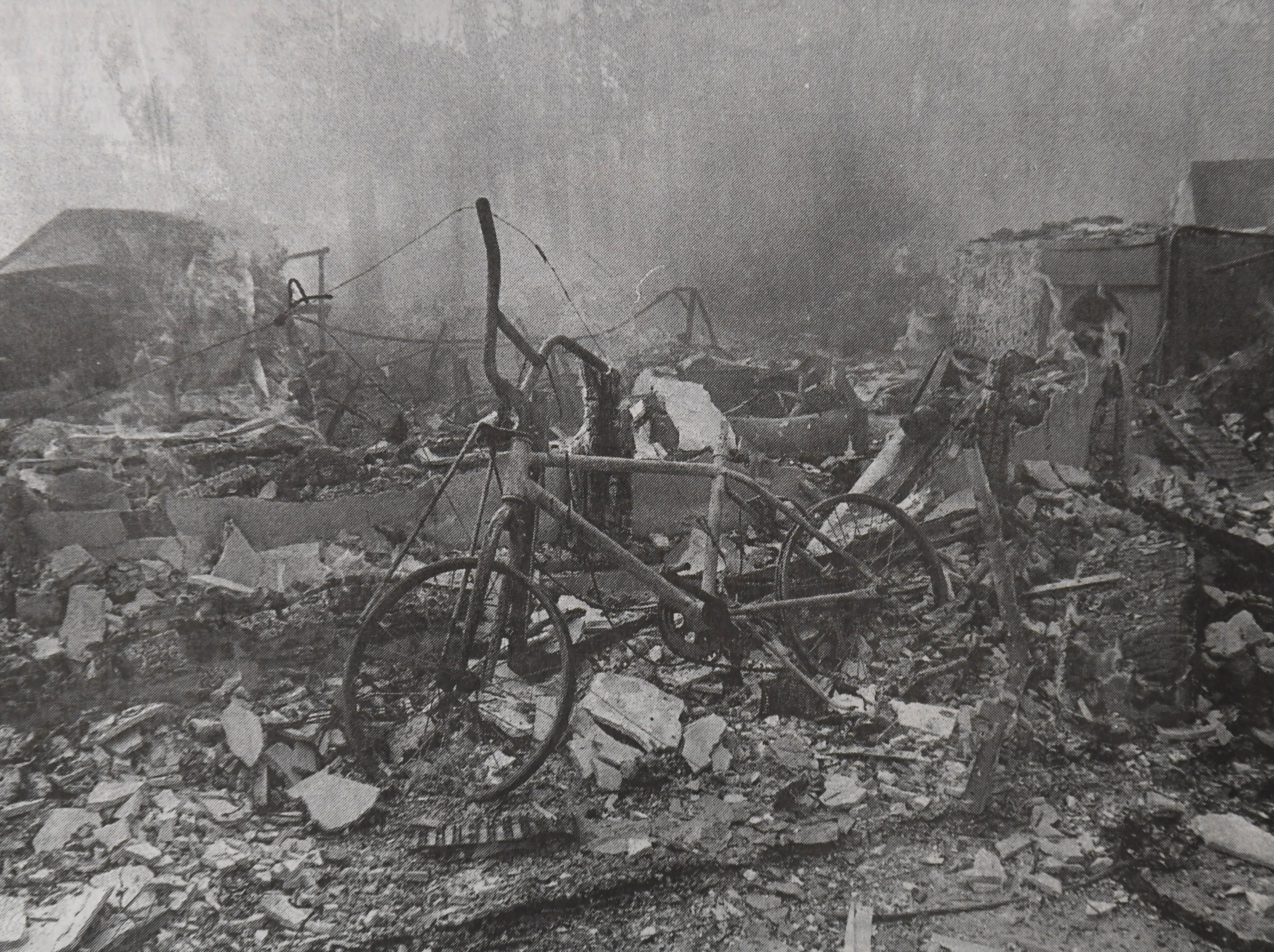 A charred bicycle was one of only a few recognizable remains of a residence that was destroyed by fire April 15, 1999, on Urbino Avenue in Port St. Lucie.