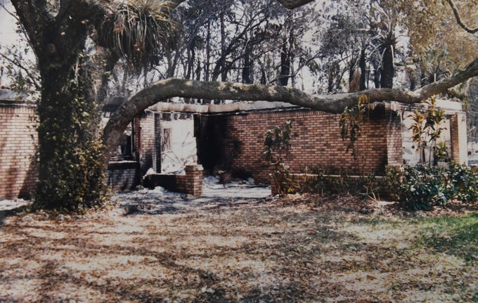 The remains of Michael and Linda Boogaart's concrete block house on Urbino Avenue in Port St. Lucie is seen in a photograph after it was destroyed in 1999 brush fire that consumed more than 40 homes in Port St. Lucie.