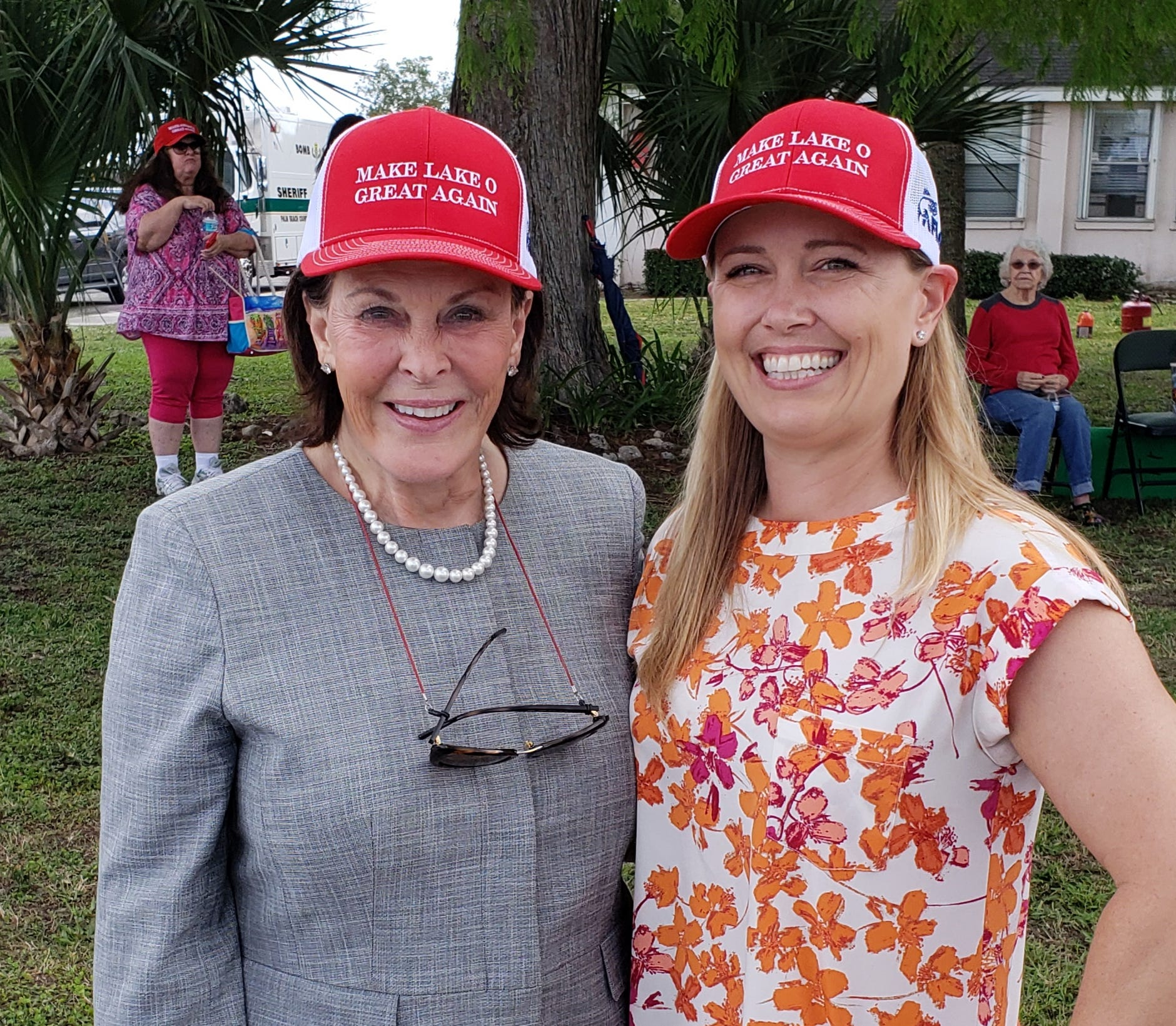Make Lake O Great Again hats, modeled here by Mary Ann Martin of Clewiston (left) and Nyla Pipes of Fort Pierce, were very popular Friday during President Donald Trump's visit to Canal Point.