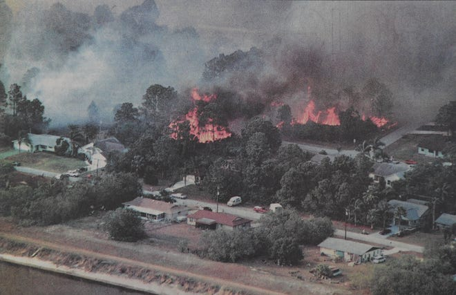 Flames engulf a neighborhood near the C-24 Canal on April 15, 1999, in Port St. Lucie.