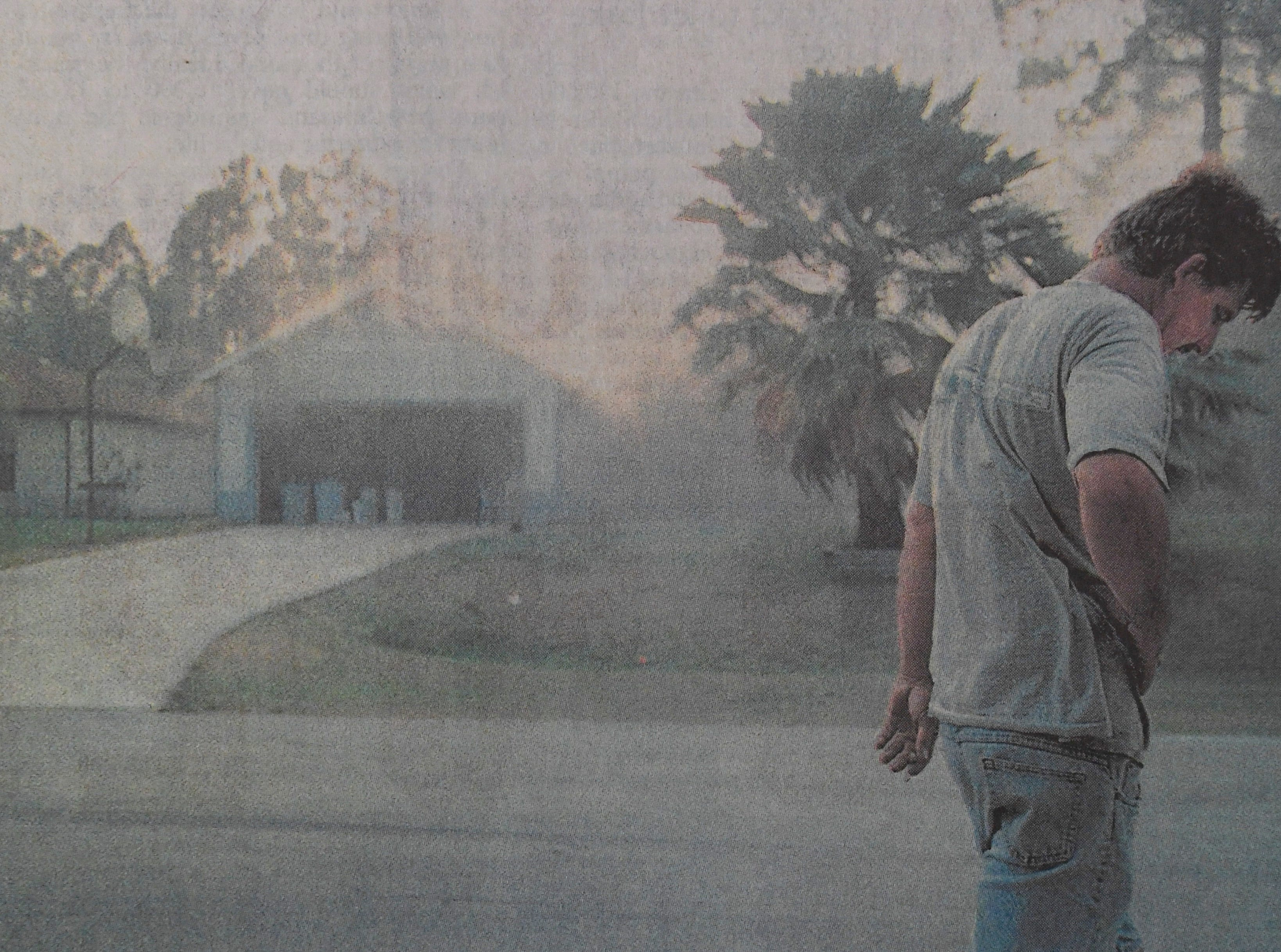Jeff O'Neil paces in front of his home April 15, 1999, on National Circle in Port St. Lucie as it burns. O'Neil, who lived in the house for 10 years, said he removed any valuables that fit in his car.
