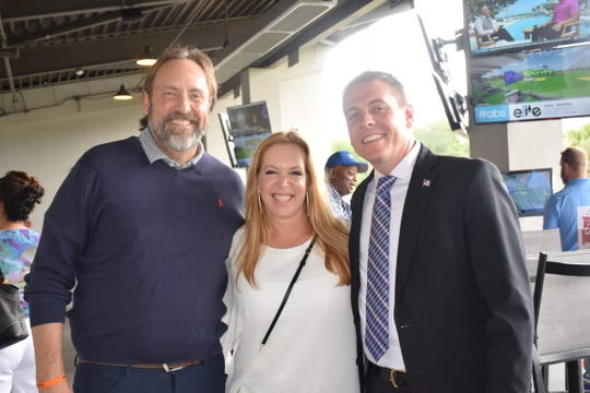 """Vero Beach Mayor Val Zudans, left, Tracey Zudans and Eric Flowers, of the Vero Beach Police Department, at Big Shots Golf for the Live Like Cole Foundation's Golfing """"Fore""""A Purpose event."""