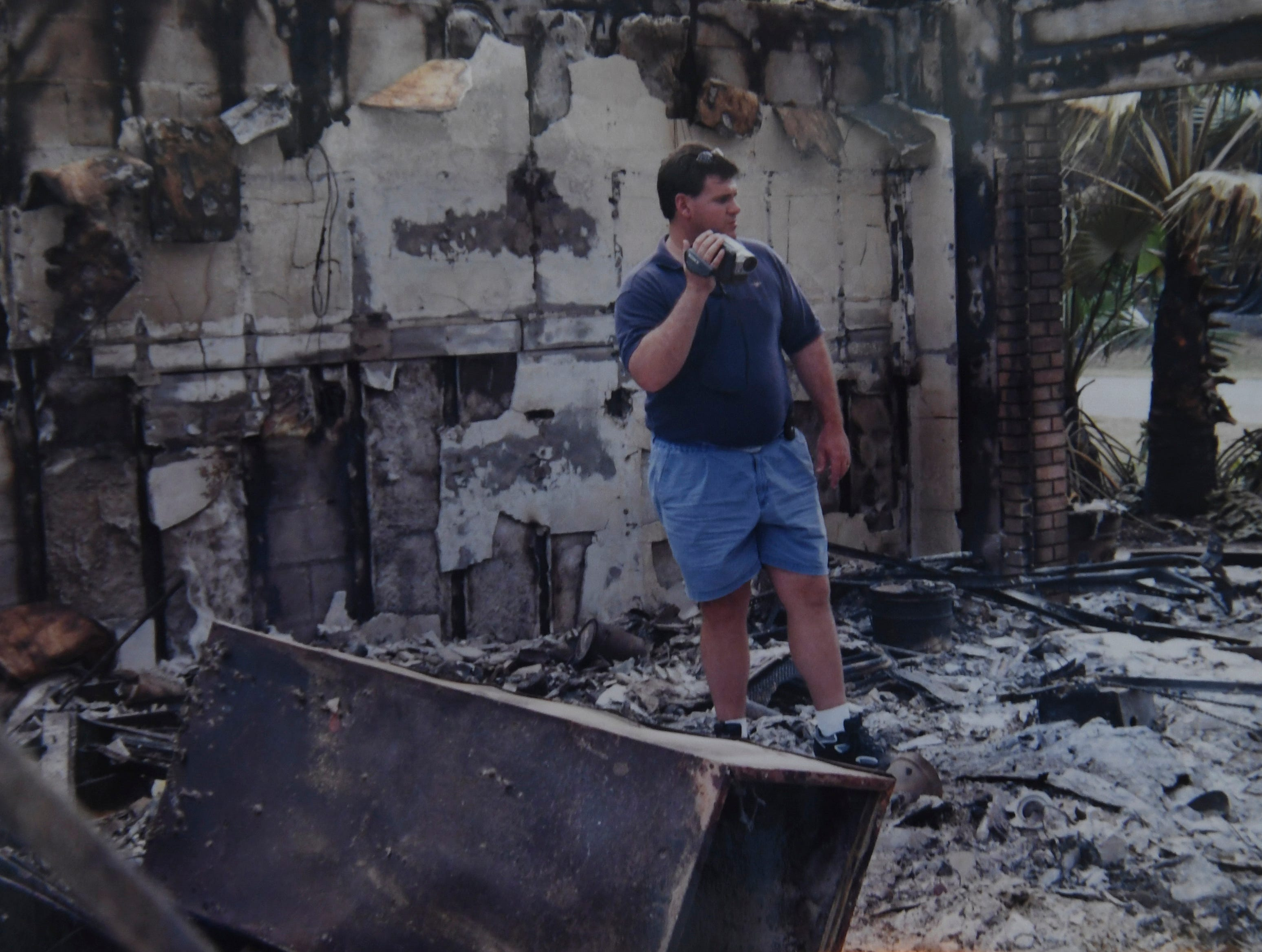 Michael Boogaart recorded the remains of his home from inside the garage on Urbino Avenue in Port St. Lucie after it was destroyed in the April 15, 1999, brush fires in Port St. Lucie.