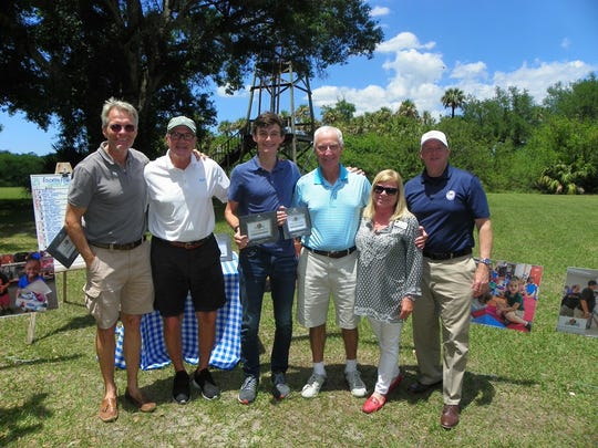 Windsor Gun Club Director Nicky Szapary, left, with second place winners Ivor Zimmerman, Ric Zimmerman and Alastair Kennedy, Education Foundation President Cathy Filusch and Schools Superintendent Dr. Mark Rendell at the 2018 Charity Shoot at Windsor Gun.