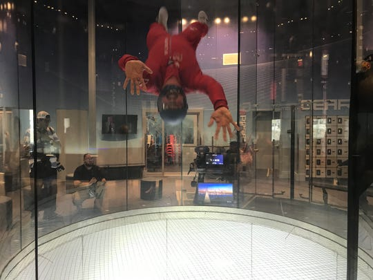 An iFly Indoor Skydiving instructor shows off his Spiderman like moves while inside the wind tunnel.